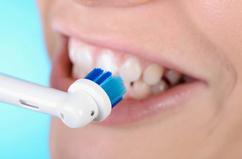elektrische Zahnbürste oder Handzahnbürste